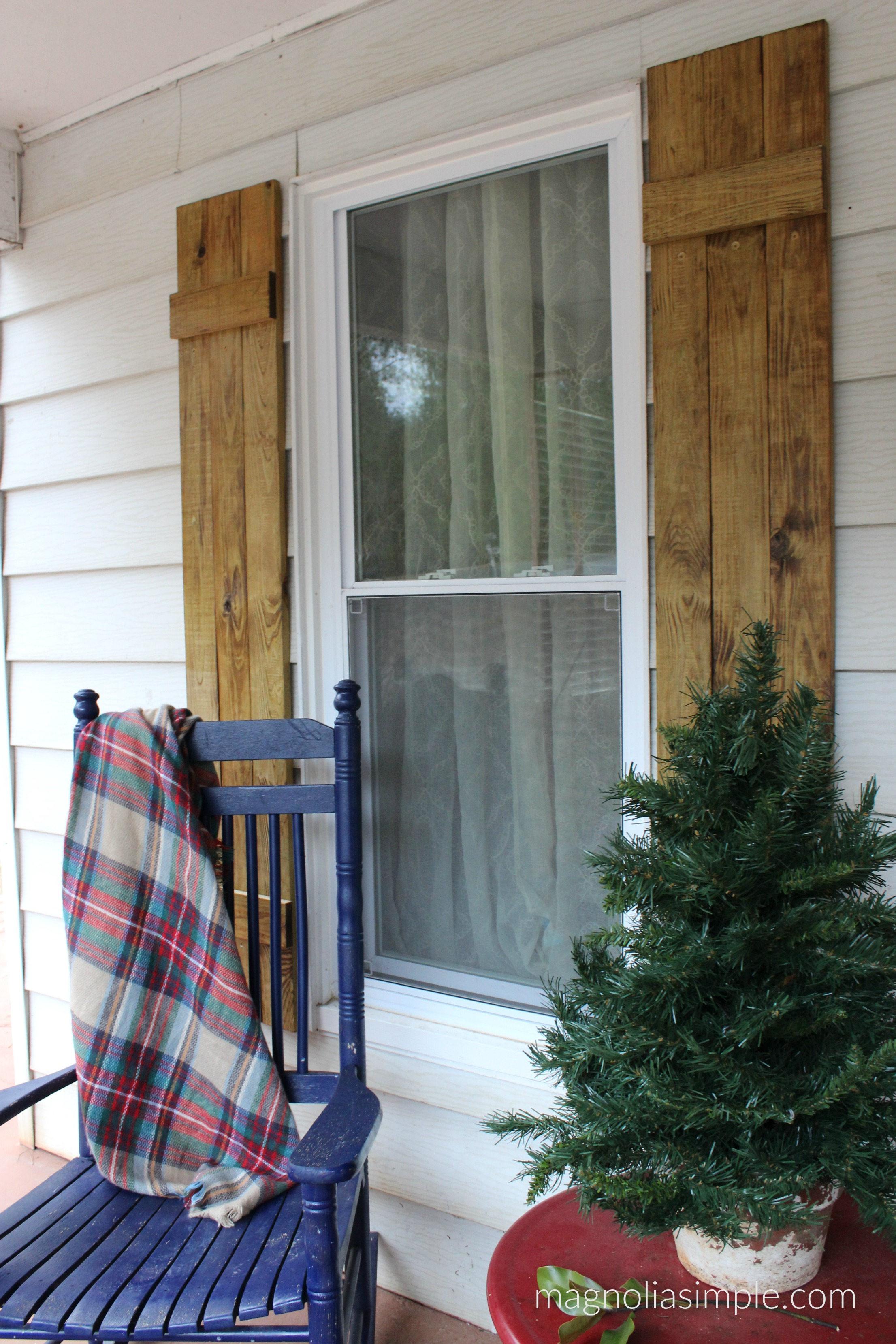 natural wood shutters front porch.jpg